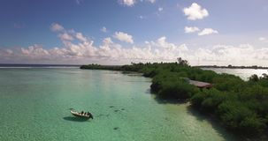 Boat and Tropical Island. Aerial shot of a boat near a tropical island stock footage