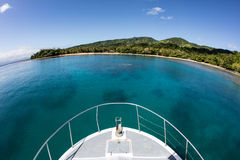 Boat and Tropical Island in Fiji Stock Image
