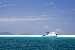 Boat at Tropical Island Paradise Stock Photo