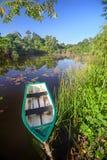 Boat on tropical lake Stock Photo