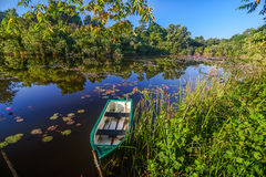 Boat on tropical lake Stock Photography