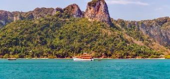 Boat in tropical resort island andaman sea in Krabi, Thailand. Boat in tropical resort and limestone rocks island andaman sea in Krabi, Thailand Royalty Free Stock Images