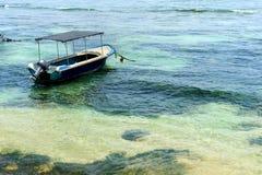 Boat in tropical sea Stock Photo