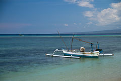 Boat at turquoise reef within sea stock photography