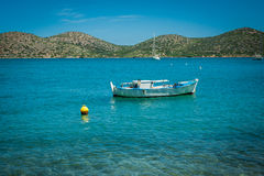 Boat on the turquoise water, Greece, Crete, island behind Royalty Free Stock Image