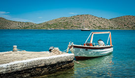 Boat on the turquoise water, Greece, Crete, island behind Stock Image
