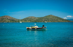Boat on the turquoise water, Greece, Crete, island behind Royalty Free Stock Photo