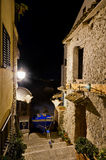 The boat between two houses. A boat of Chianalea (Scilla, Reggio Calabria) away before the arrival of bad weather at night Royalty Free Stock Photography