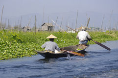 Boat with two people on Inle Lake. Royalty Free Stock Photography