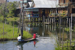 Boat with two people on Inle Lake. Royalty Free Stock Images