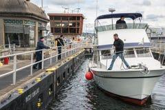 Boat Tying Up in Seattle Ballard Locks Royalty Free Stock Images