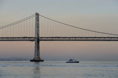 Boat under the Bay Bridge Royalty Free Stock Images