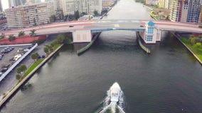 Boat under the bridge stock video