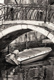Boat under a Bridge in Venice. Black and White Royalty Free Stock Images