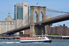 Boat under Brooklyn Bridge Royalty Free Stock Photo