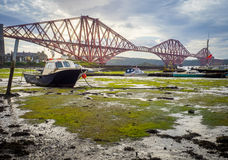 Boat under the Forth Rail Bridge in Edinburgh Royalty Free Stock Image