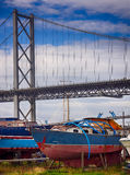 Boat under the Forth Road Bridge in Edinburgh Stock Photography