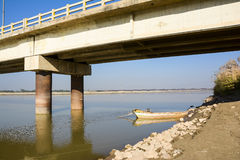 Boat under Khushab Bridge - Jhelum River. Khushab Bridge over Jhelum River located in Khushab, Punjab, Pakistan. Jehlam River or Jhelum River is a river that stock photos