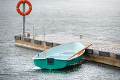 Boat under the summer rain Royalty Free Stock Photography