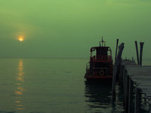 Boat under sun set Royalty Free Stock Images