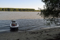 Boat under trees. The boat is resting under trees on the island royalty free stock photo