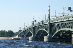 Boat under Troitsky Bridge. In Saint Petersburg, Russia stock photos