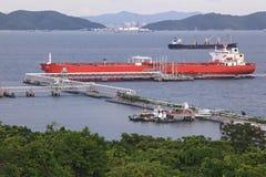 Boat unloading cargo Stock Photo