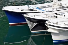 Boat of various colors ready to set sail stock photos