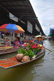 Boat vendor selling roses and pandan leaves at floating market around Bangkok area Stock Photos