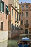 Boat in Venetian canal Royalty Free Stock Image