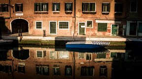 Boat on the Venetian canal Stock Photography