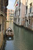 Boat on Venetian canal Stock Photography