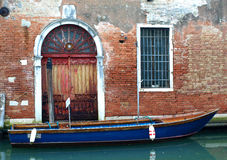 Boat on Venetian Side canals Stock Images