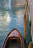 Boat in Venice. Mahogany boat tied up on canal in Venice Royalty Free Stock Photo