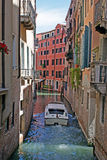 Boat on venice channel. Boat on venice narrow channel royalty free stock photos