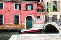 Boat in Venice, Italy. Detail of a boat in front of a venetian house Royalty Free Stock Photo