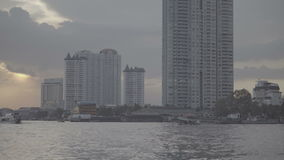 Boat view from Chao Praya river on Bangkok. During beautiful sunset; Thailand stock video footage