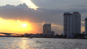 Boat view from Chao Praya river on Bangkok. During beautiful sunset; Thailand stock video
