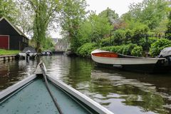 Boat view of rural North Holland town canal and other boats royalty free stock photography