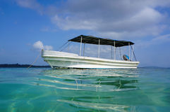Boat viewed from water surface in Caribbean sea Royalty Free Stock Images