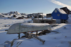 Boat and village in winter, Greenland. House and boat in the Kulusuk village, Greenland Royalty Free Stock Photography