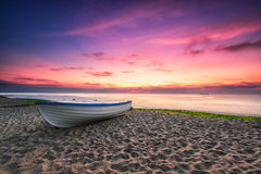 Boat and violet sunrise Stock Photo