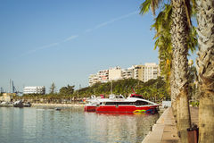 A boat Vision stands on the dock, Alicante, Spain. ALICANTE, SPAIN - SEPTEMBER 9, 2014: a boat with the name Vision the Fort stands on the dock at the waterfront Royalty Free Stock Photo
