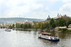 Boat on Vltava river near Kosarkovo, Prague Stock Images
