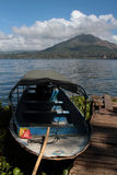 Boat and Volcano Batur Royalty Free Stock Images
