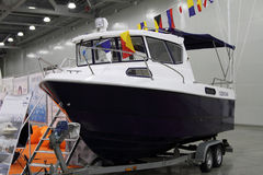 Boat VYMPEL 7000 OUTBOARD in the exhibition Crocus Expo in Mosco Stock Images