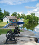 Boat waiting at dock next to channel lock. Stock Images