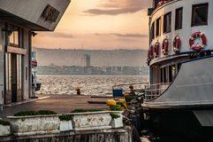 The boat is waiting for passengers at the ferry. City landscape in the background. izmir. Turkey stock photo
