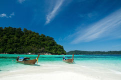 Boat waiting for tourist in clear sea and white sand beach at Li Stock Images