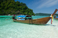 Boat waiting for tourist in clear sea and white sand beach at Li Stock Photos